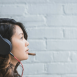 woman listening to music on spotify via headphones
